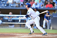 Asheville Tourists Cade Harris (4) swings at a pitch during a game against the Charleston RiverDogs at McCormick Field on August 16, 2019 in Asheville, North Carolina. The Tourists defeated the RiverDogs 12-3. (Tony Farlow/Four Seam Images)