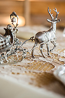 Detail of Austrian silver ornamental stag and sleigh on the dining table