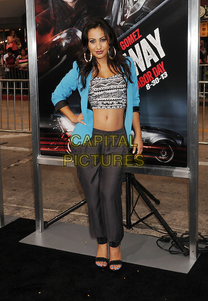 Francia Raisa<br /> &quot;Getaway&quot; Los Angeles Premiere held at the Regency Village Theatre, Westwood, California, USA.<br /> August 26th, 2013<br /> full length black joggers trousers blue turquoise blazer grey gray print hand on hip cropped top belly stomach midriff<br /> CAP/ROT/TM<br /> &copy;Tony Michaels/Roth Stock/Capital Pictures