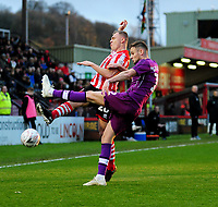 Lincoln City's Harry Anderson vies for possession with Carlisle United's Jerry Yates<br /> <br /> Photographer Andrew Vaughan/CameraSport<br /> <br /> The Emirates FA Cup Second Round - Lincoln City v Carlisle United - Saturday 1st December 2018 - Sincil Bank - Lincoln<br />  <br /> World Copyright © 2018 CameraSport. All rights reserved. 43 Linden Ave. Countesthorpe. Leicester. England. LE8 5PG - Tel: +44 (0) 116 277 4147 - admin@camerasport.com - www.camerasport.com