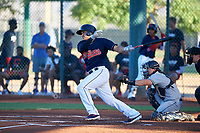 AZL Indians Red Yainer Diaz (4) at bat in front of catcher Chandler Seagle (11) during an Arizona League game against the AZL Padres 1 on June 23, 2019 at the Cleveland Indians Training Complex in Goodyear, Arizona. AZL Indians Red defeated the AZL Padres 1 3-2. (Zachary Lucy/Four Seam Images)
