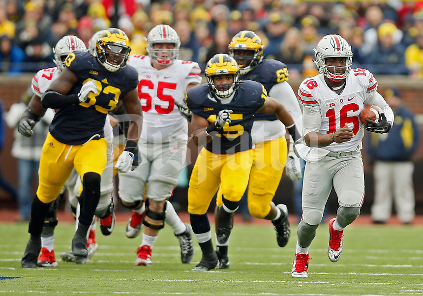 Ohio State Buckeyes quarterback J.T. Barrett (16) carries the ball up the field against Michigan Wolverines in the 2nd quarter at Michigan Stadium in Arbor, Michigan on November 28, 2015.  (Dispatch photo by Kyle Robertson)