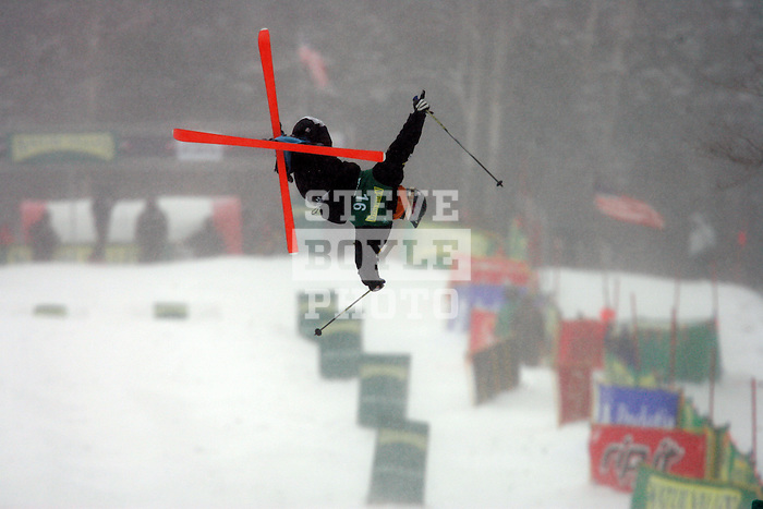 Sho Kashima (USA) performs a trick off of the second jump during the mens' finals on the Wilderness Trail of Whiteface Mountain in Lake Placid, New York during the FIS Freestyle World Cup on January 20, 2008.