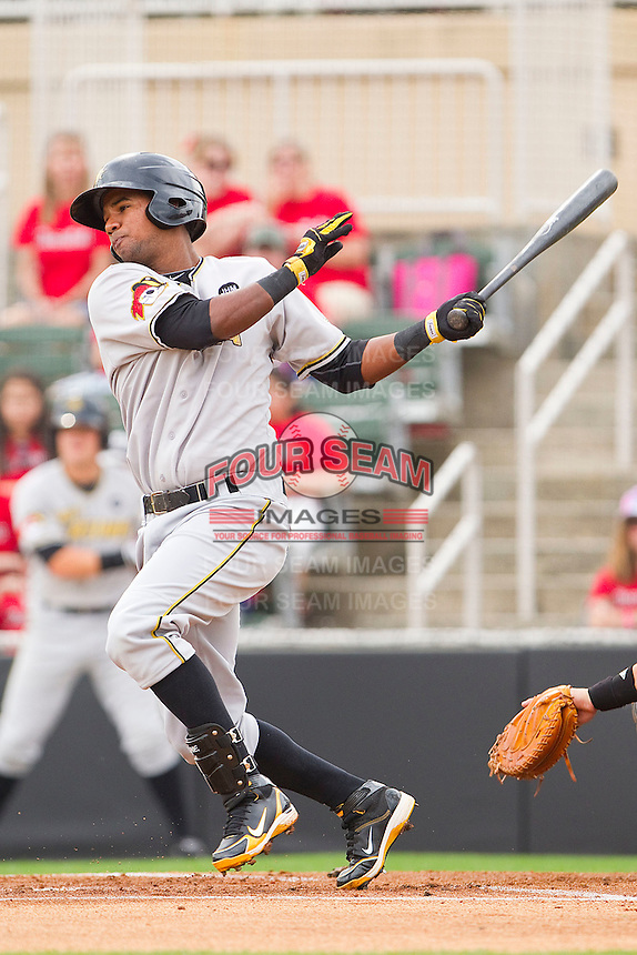 Eric Avila #15 of the West Virginia Power follows through on his swing against the Kannapolis Intimidators at Fieldcrest Cannon Stadium on April 20, 2011 in Kannapolis, North Carolina.   Photo by Brian Westerholt / Four Seam Images