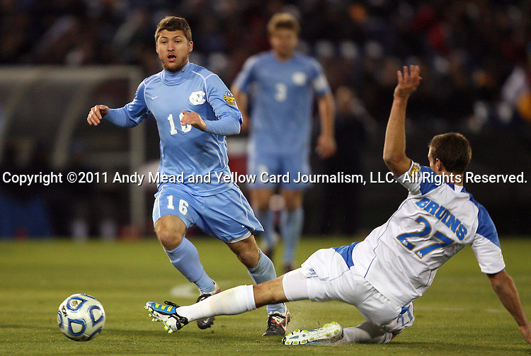 09 December 2011: UCLA's Joe Sofia (27) knocks the ball away from North Carolina's Enzo Martinez (16). The University of California Los Angeles Bruins played the University of North Carolina Tar Heels to a 2-2 tie after overtime, with the Tar Heels advancing with a 3-1 win in the penalty kick shootout at Regions Park in Hoover, Alabama in an NCAA Division I Men's Soccer College Cup semifinal game.