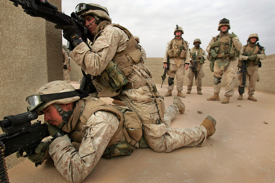 Machine-gunners with Golf Co. 2nd Battalion 1st Marines search for an elusive opponent from a roof-top position during the third day of Operation Steel Curtain, an operation to clear Husaybah (a city on the Iraq-Syrian border) of insurgents on Tues. Nov. 8, 2005.