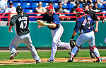 8 March 2010: Washington Nationals' third baseman Ryan Zimmerman catches Florida Marlins starting pitcher Ricky Nolasco in a rundown during a Spring Training game at Space Coast Stadium in Viera, Florida. The Marlins defeated the Nationals 12-2 in Grapefruit League action. Mandatory Credit: Ed Wolfstein Photo