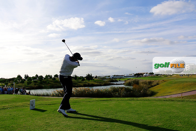 Alvaro Quiros (ESP) tees off the 18th tee during Saturday's Round 3 of the 2013 Portugal Masters held at the Oceanico Victoria Golf Club. 12th October 2013.<br />
