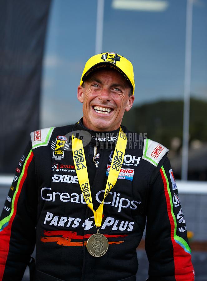 Jun 18, 2017; Bristol, TN, USA; NHRA top fuel driver Clay Millican celebrates after winning the Thunder Valley Nationals at Bristol Dragway. Mandatory Credit: Mark J. Rebilas-USA TODAY Sports