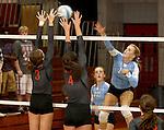 SIOUX FALLS, SD - SEPTEMBER 16: Rochelle Ramharter #3 and Caryn Hazard #4 from Washington try for a block on Michelle Haas #10 from Lincoln try for a block on in the second game of their match Tuesday night at Lincoln.  (Photo by Dave Eggen/Inertia)