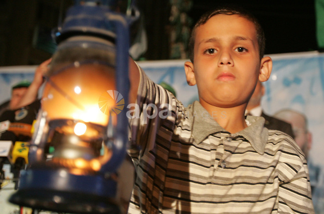 Palestinian Hamas supporter holds gasoline lamp during a protest against the lack of fuel to Gaza's power station, and the continued power outages in the city, on June 29, 2010 in Gaza City. Photo by Ali Jadallah