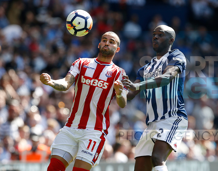 Jese of Stoke City Allan-Romeo Nyom of West Bromwich Albion during the premier league match at the Hawthorn's Stadium, West Bromwich. Picture date 27th August 2017. Picture credit should read: Simon Bellis/Sportimage