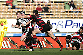 Cameron McIntyre goes high to try & stop Nigel Watson during the Ranfurly Shield challenge against Canterbury at Jade Stadium on the 10th of September 2006. Canterbury won 32 - 16.