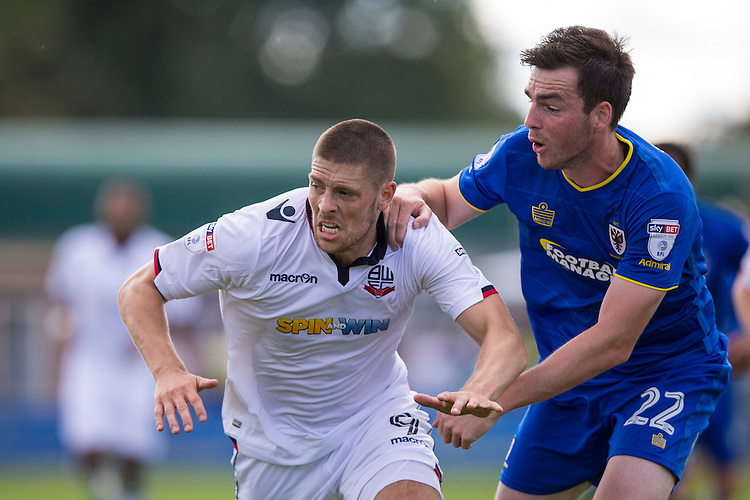 Bolton Wanderers' Jamie Proctor battles with AFC Wimbledon's Sean Kelly<br /> <br /> Photographer Craig Mercer/CameraSport<br /> <br /> Football - The EFL Sky Bet League One - AFC Wimbledon v Bolton Wanderers - Saturday 13th August 2016 - The Cherry Red Records Stadium - London<br /> <br /> World Copyright &copy; 2016 CameraSport. All rights reserved. 43 Linden Ave. Countesthorpe. Leicester. England. LE8 5PG - Tel: +44 (0) 116 277 4147 - admin@camerasport.com - www.camerasport.com