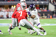Indianapolis, IN - December 1, 2018: Northwestern Wildcats defensive lineman Jordan Thompson (99) sacks Ohio State Buckeyes quarterback Dwayne Haskins (7) during the Big Ten championship game between Northwestern  and Ohio State at Lucas Oil Stadium in Indianapolis, IN.   (Photo by Elliott Brown/Media Images International)
