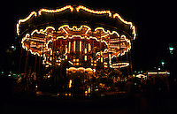 Old-fashioned carousel light up at night, Marseille, France.