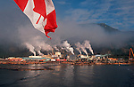 Pulp Mill pollution, Vancouver Island, Canadian flag, Gold River, British Columbia, Canada.