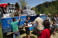 UK aid shelter kits are being distributed to thousands of people who have lost their homes in remote parts of Nepal. Working with NGOs including MedAir, ACTED and Shelterbox, the kits are being distributed by helicopter, road and ultimately, heads, as they are carried up steep mountain trails to where they are needed.<br /> <br /> Pictures: Russell Watkins/DFID