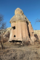 Troglodyte hermit house within a fairy chimney, in Cappadocia, Central Anatolia, Turkey. The chimneys were formed by erosion of the volcanic tuff created by ash from volcanic eruptions millions of years ago, and have caps of basalt on top which is slower to erode. Many of the chimneys have been hollowed out to form dwellings. This area forms part of the Goreme National Park and the Rock Sites of Cappadocia UNESCO World Heritage Site. Picture by Manuel Cohen