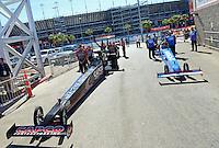 Oct. 27, 2012; Las Vegas, NV, USA: NHRA crew members with top fuel driver Steve Torrence (left) and T.J. Zizzo during qualifying for the Big O Tires Nationals at The Strip in Las Vegas. Mandatory Credit: Mark J. Rebilas-