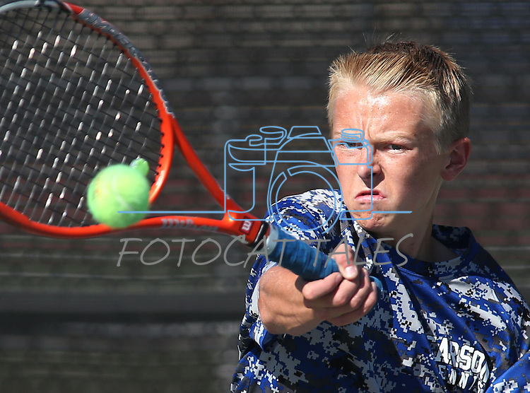 Carson High's Taylor Saarem competes against Reno High at CHS, in Carson City, Nev., on Monday, Sept. 15, 2014. Reno won 16-2.<br /> Photo by Cathleen Allison