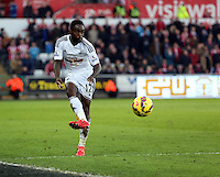 SWANSEA, WALES - FEBRUARY 07: Nathan Dyer of Swansea kicks the ball ball forward during the Premier League match between Swansea City and Sunderland AFC at Liberty Stadium on February 7, 2015 in Swansea, Wales.