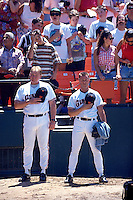 SAN FRANCISCO, CA - Pitching coach Dick Pole and pitcher Bill Swift of the San Francisco Giants pause in the bullpen during the National Anthem before a game against the Atlanta Braves at Candlestick Park in San Francisco, California on August 25, 1993. Photo by Brad Mangin