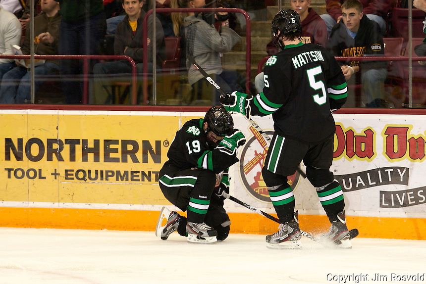 6 Nov 11: Rocco Grimaldi (North Dakota -19), Nick Mattson (North Dakota - 19).  The University of Minnesota Golden Gophers host the University of North Dakota Fighting Sioux in a WCHA matchup at Mariucci Arena in Minneapolis, MN.
