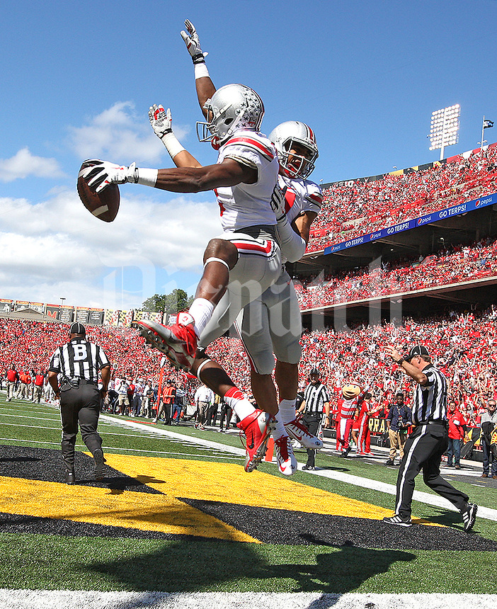 Ohio State Buckeyes wide receiver Michael Thomas (3) ( with ball) and Ohio State Buckeyes running back Jalin Marshall (17) celebrate Thomas's TD catch in the second quarter at Byrd Stadium on October 4, 2014.  (Chris Russell/Dispatch Photo)