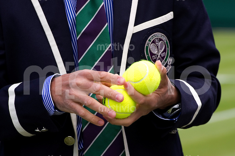 A referee checks the Slazenger balls before the members test game on Court 2 Preparation for The Wimbledon Championships 2010 The All England Lawn Tennis & Croquet Club  Saturday Pre Championships Saturday 19/06/2010