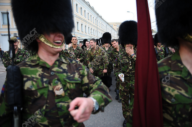 Soldiers from the Welsh Guards, wearing their traditional bearskin caps, shared a laugh as they waited near Red Square in Moscow to take part in a rehearsal for Sunday's traditional Victory Day parade marking the 65th anniversary of the end of WWII, and this time, for the first time, will include servicemen from Allied forces. Moscow Russia, May 4, 2010