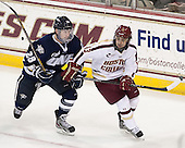 Grayson Downing (UNH - 28), Johnny Gaudreau (BC - 13) - The Boston College Eagles defeated the visiting University of New Hampshire Wildcats 5-2 on Friday, January 11, 2013, at Kelley Rink in Conte Forum in Chestnut Hill, Massachusetts.