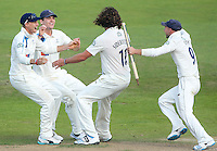 Picture by Alex Whitehead/SWpix.com - 12/09/2014 - Cricket - LV County Championship Div One - Nottinghamshire CCC v Yorkshire CCC, Day 4 - Trent Bridge, Nottingham, England - Yorkshire's Ryan Sidebottom (second right) celebrates with team-mates the Championship winning wicket.
