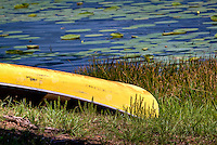 A canoe on the bank of Lake Leatherwood city Park just outside of Eureka Springs Arkansas.
