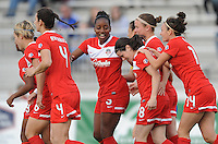Boyds MD - April 19, 2014: Diana Matheson (8) of the Washington Spirit celebrates with teammates her score. The Washington Spirit defeated the FC Kansas City 3-1 during a regular game of the 2014 season of the National Women's Soccer League at the Maryland SoccerPlex.