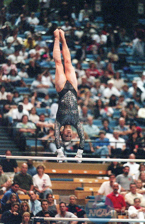 18 APR 1998: Angie Leonard competes on the uneven bars  during the Division 1 Women's Gymnastics Championships held in Pauley Pavillion on the UCLA campus in Los Angeles, CA. Leonard placed twelfth in the event. Hans Gutknecht/NCAA Photos.