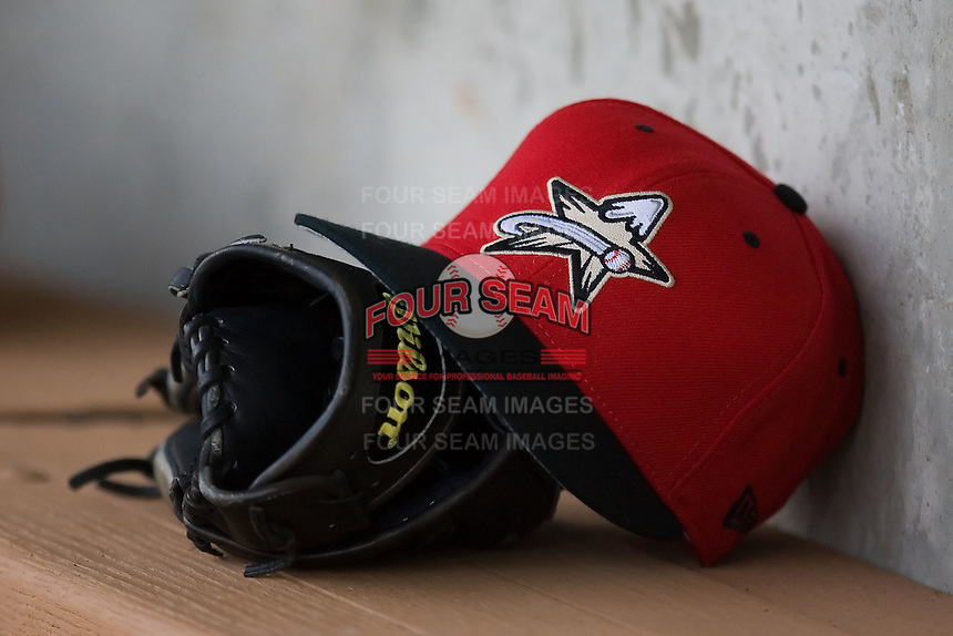 A Salem Avalanche cap rests on a glove in the visitors dugout at Ernie Shore Field in Winston-Salem, NC, Friday April 11, 2008.