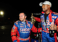 Nov 14, 2010; Pomona, CA, USA; NHRA top fuel dragster driver Shawn Langdon (left) congratulates Antron Brown celebrates after winning the Auto Club Finals at Auto Club Raceway at Pomona. Mandatory Credit: Mark J. Rebilas-