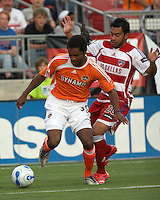 Houston Dynamo's Adrian Serioux (51) shields the ball from FC Dallas' Carlos Ruiz (20) at Robertson Stadium in Houston, TX on Saturday May 6, 2006. The Houston Dynamo defeated FC Dallas 4-3.