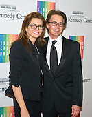 Actor Kyle MacLachlan and his wife, Desiree Gruber, arrive for the formal Artist's Dinner honoring the recipients of the 2014 Kennedy Center Honors hosted by United States Secretary of State John F. Kerry at the U.S. Department of State in Washington, D.C. on Saturday, December 6, 2014. The 2014 honorees are: singer Al Green, actor and filmmaker Tom Hanks, ballerina Patricia McBride, singer-songwriter Sting, and comedienne Lily Tomlin.<br /> Credit: Ron Sachs / Pool via CNP
