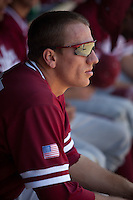 LOS ANGELES, CA - April 10, 2011: Stephen Piscotty of Stanford baseball sits in the dugout before Stanford's game against USC at Dedeaux Field in Los Angeles. Stanford lost 6-2.