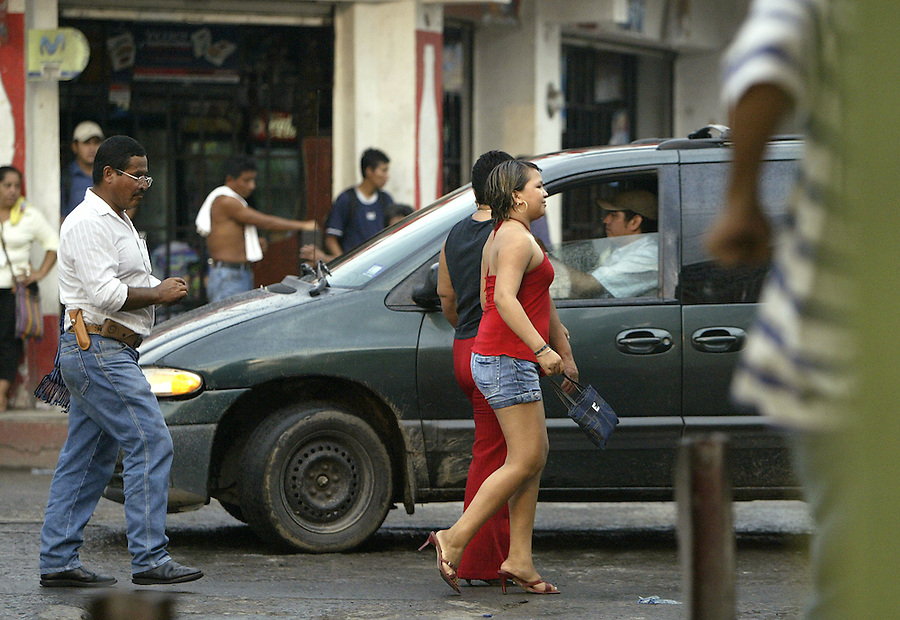 """Drugs and prostitution feed the transitory population of Tecun Uman. """"Men knock on the door asking if there's any women that want to work,"""" says Maria Dolores Padilla Bustamente, 41, a volunteer at Casa del Migrante, or House of Migrants. The city gained its nickname, """"Little Tijuana"""", from the seediness grown from its transient community and the number of bars and brothels that have popped up since the early 1990's..."""