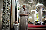 BAGHDAD, Iraq: 11th June 2014<br /> <br /> A man prays inside Abu Hanifa, a Sunni mosque in Baghdad's Adhamiya. Sunni Muslims pray five times a day.  Unlike Shia. they pray while folding their arms. <br /> <br /> <br /> Fixer: Haider Kata +9647704425647<br /> <br /> Ayman Oghanna for National Geographic