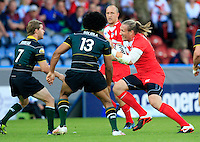 PICTURE BY CHRIS MANGNALL /SWPIX.COM...Rugby League - International Origin Match  - England v Exiles - Galpharm Stadium, Huddersfield, England  - 04/07/12... England's  Eorl Crabtree tackled by Exiles Sia Soliola