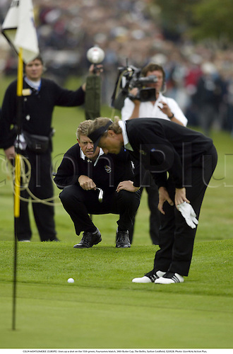 COLIN MONTGOMERIE (EUROPE)  lines up a shot on the 15th green, Foursomes Match, 34th Ryder Cup, The Belfry, Sutton Coldfield, 020928. Photo: Glyn Kirk/Action Plus....2002.golf golfer player...... .....