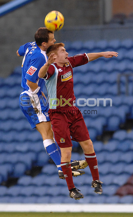 Pix: Howard Roe/SWpix.com. Football, Coca Cola Championship, Burnley v Birmingham , 25/11/06. 3.00pm KO..copyright picture>>simon wilkinson>>07811267706>>. Birmingham's Stephen Clemence out jumps Burnley's Jsames O'Conner