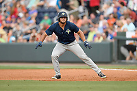 Left fielder Tim Tebow (15) of the Columbia Fireflies takes a lead off first base in a game against the Greenville Drive on Wednesday, June 14, 2017, at Fluor Field at the West End in Greenville, South Carolina. Columbia won, 6-2, in 11 innings. (Tom Priddy/Four Seam Images)