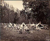 BNPS.co.uk (01202 558833)<br /> Pic: DominicWinter/BNPS<br /> <br /> A shooting party in Camp, Srinuggur.<br /> <br /> Fascinating 150 year-old photographs of India taken in the aftermath of the failed mutiny have sold for almost &pound;8,000 at auction.<br /> <br /> The images, which date from 1863 to 1870, capture native soldiers with their weapons and picturesque landscapes and were taken by celebrated 19th century photographer Samuel Bourne.<br /> <br /> They went for a hammer price of &pound;6,400 to a private collector from America who bid online with extra fees pushing the overall price above &pound;7,800.<br /> <br /> Together with Charles Shepherd, Bourne set up photo studio Bourne &amp; Shepherd first in Simla in 1863 and later in Calcutta.
