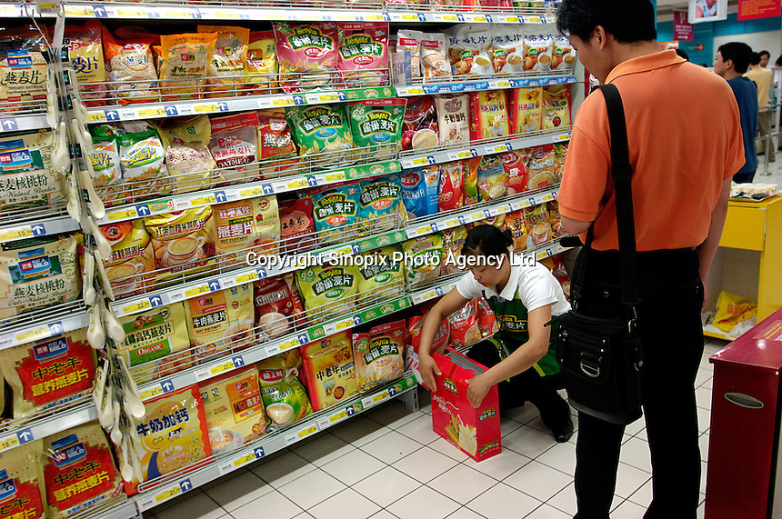Nestle oats products are on sale with a promotion in a Carrefour supermarket in Beijing, China. Major international chains like Carrefour and Walmart Stores have expanded aggressively in China. Local Chinese retailers have loudly protested this and lobbied heavily for protection from the new competition in price and service that these major retailers have set off..22 Jul 2006