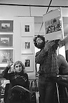 "The Photographers Gallery Great Newport Street London 1971.""Co Optic""  Christmas Print Auction. Dorothy Bohm bidding for a Tony Ray Jones print being held up by the photographer Bob Mazzer."